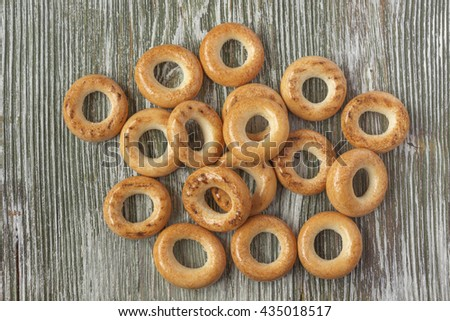 Wooden rustic table with national russian bagels - stock photo