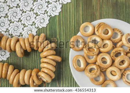 Wooden rustic table with national russian bagels. A group of bagels on a blue wooden table, top view - stock photo
