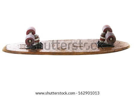 Wooden 70's skate board on a white background - stock photo