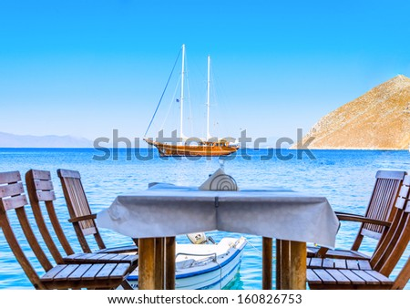 wooden sailing ship is at anchor view from the shore - stock photo