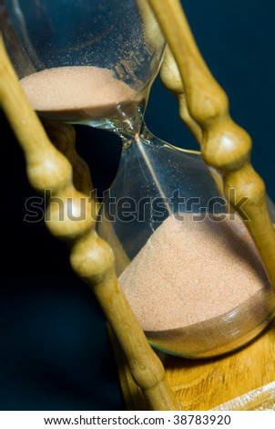 Wooden sand glass on a dark background - stock photo