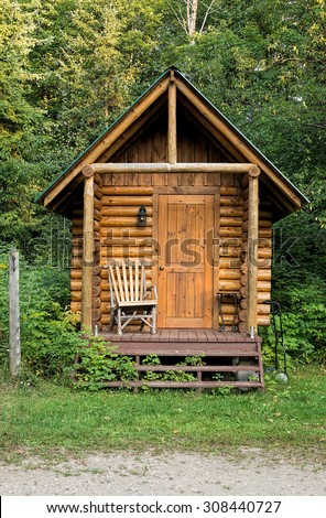 Wooden sauna building with a peak roof - stock photo