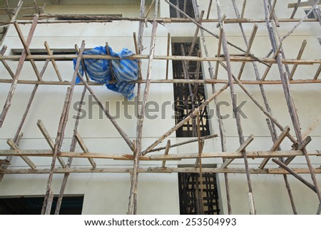 Wooden scaffold at the High building construction - stock photo