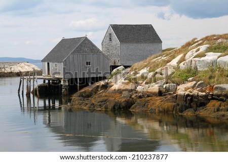 Wooden seaside fishing shacks on the rocks at Peggy's Cove, Nova Scotia, Canada - stock photo