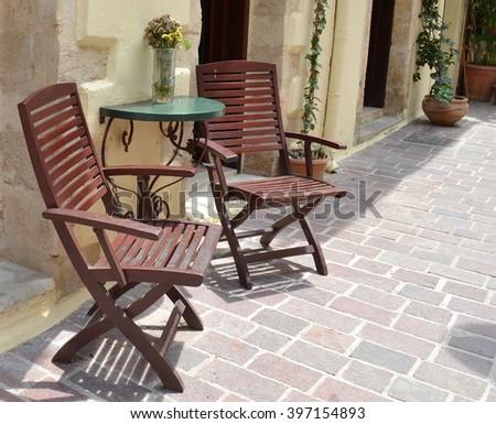 Wooden Seats on Street - Alfresco Dining - stock photo