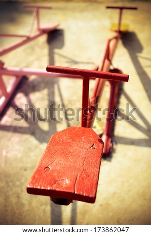 Wooden seesaw in the park, playground for kids - stock photo