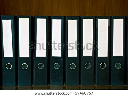 Wooden Shelf with document Folders and blank label - stock photo