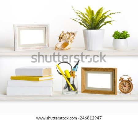 Wooden shelves with different office related objects - stock photo
