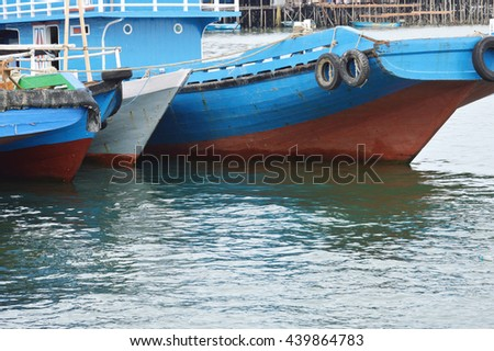 wooden ship at seaport - stock photo