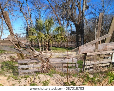 Wooden shipping pallets have been recycled into fencing material for livestock in a southern climate. - stock photo