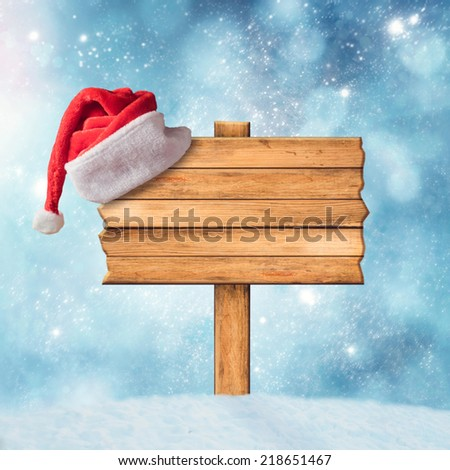 Wooden sign and Santa Claus Hat - stock photo
