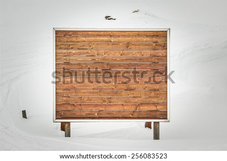 Wooden sign board on winter background - stock photo
