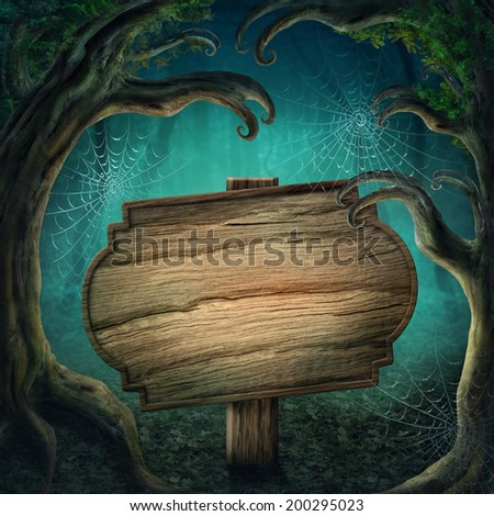 Wooden sign in the magic dark forest - stock photo