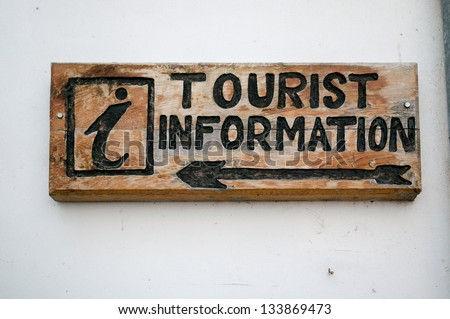 Wooden Sign of Tourist information On A Wall - stock photo