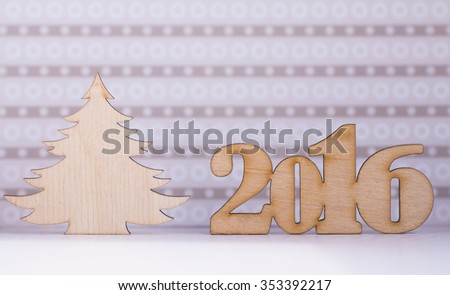 Wooden sign of 2016 year and Christmas tree on lilac background. - stock photo