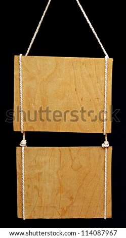 wooden sign on black background - stock photo