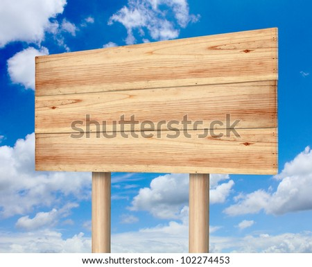 Wooden sign with blue sky - stock photo