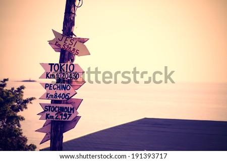 wooden signpost in a Sardinian beach - stock photo