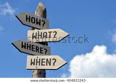 "Wooden signpost with four arrows - ""how? what? where? when?"" questions, Great for topics like frequently asked questions (faq), customer support, strategy etc. - stock photo"
