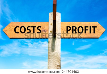 Wooden signpost with two opposite arrows over clear blue sky, Costs and Profit, Business profitability conceptual image - stock photo