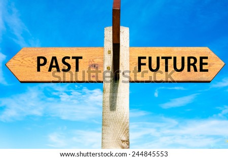 Wooden signpost with two opposite arrows over clear blue sky, Past versus Future messages, Mindset conceptual image - stock photo