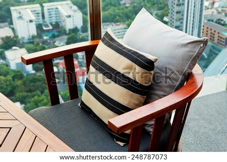 Wooden sofa in the lounge a garden setting. - stock photo