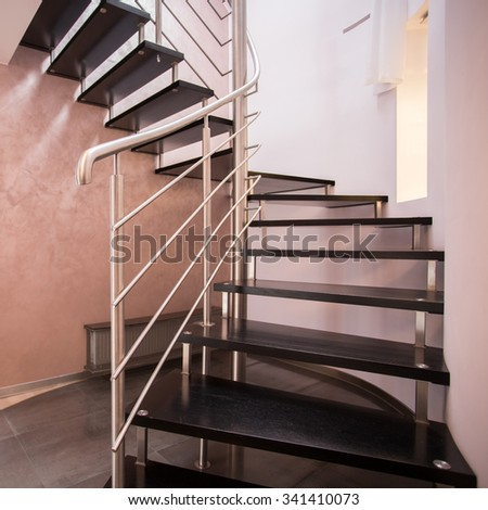 Wooden spiral stairs in luxury modern house - stock photo