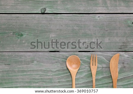 Wooden spoon and fork, knife on wood background  - stock photo
