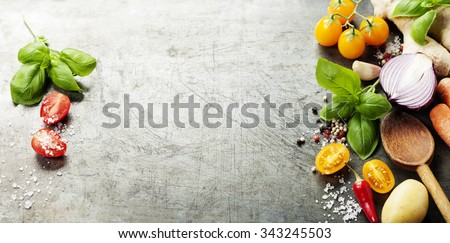 Wooden spoon and ingredients on old background. Vegetarian food, health or cooking concept.  Background layout with free text space. - stock photo
