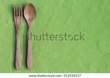 Wooden spoon on matcha green tea - stock photo