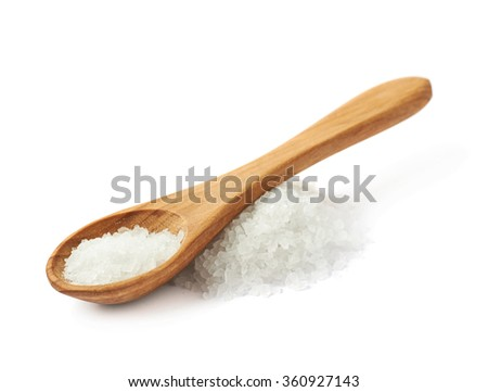 Wooden spoon over the salt - stock photo