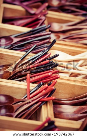 wooden spoon small teaspoons new unused made of brown hard wood for sale on a street market in Thailand - stock photo