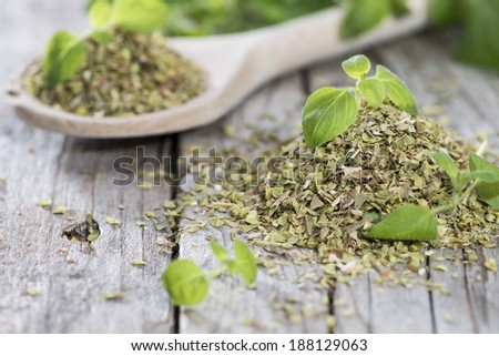 Wooden Spoon with shredded Oregano (close-up shot) - stock photo
