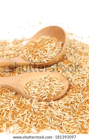 Wooden spoon with wheat with husk and purified. On a white background. - stock photo