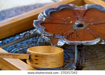 wooden spoons ladle for get water from Purification fountain at a shrine Japan - stock photo