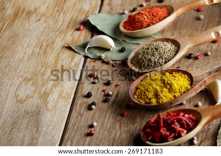 Wooden spoons of spices on table with copy-space - stock photo