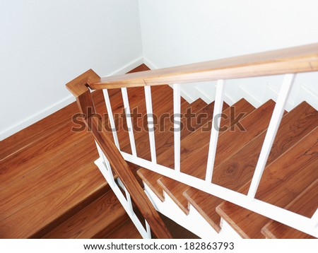 wooden staircase in a white modern house - stock photo