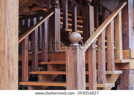 wooden staircase interior in the old woodhouse at Thailand. - stock photo