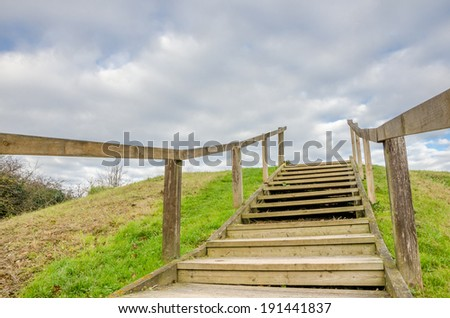 Wooden Staircase on the Hillside and Cloudy Sky - stock photo