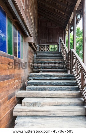 Wooden staircase to the top floor of the old house. - stock photo