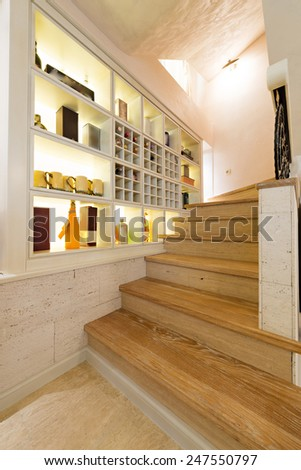 wooden stairs in luxury home interior - stock photo