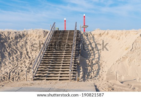 wooden stairs over a sand dune on the 2nd maasvlakte in Rotterdam. This area, opened in May 2013, means an expansion of the harbor with 20 per cent. - stock photo