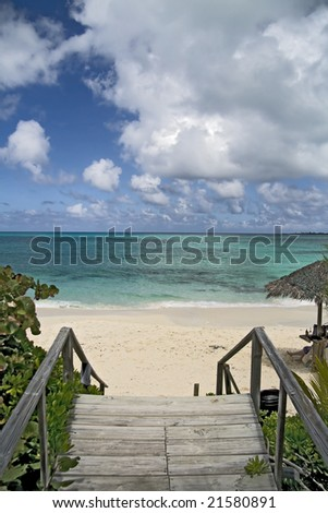 Wooden step entrance to beautiful tropical beach. - stock photo