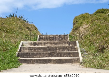 Wooden steps at a beach - stock photo