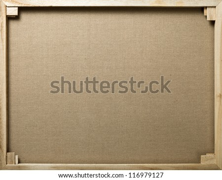 Wooden stretcher with cotton canvas for background - stock photo