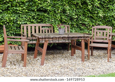 Wooden table and chair furniture in garden. - stock photo