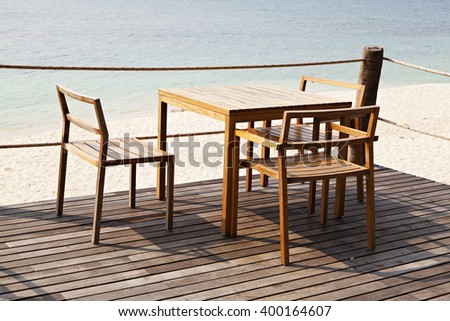 wooden table and chair on the deck - stock photo