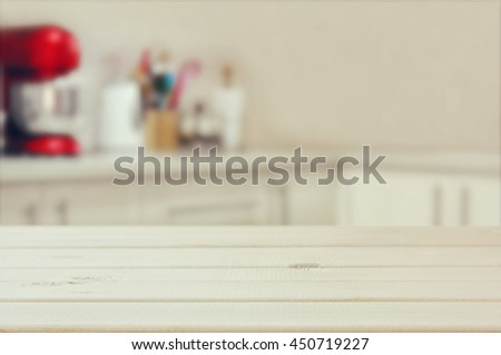 Wooden table in front of defocused white retro kitchen background. Ready for product display montage - stock photo