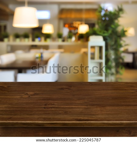Wooden table on blurred room interior background - stock photo