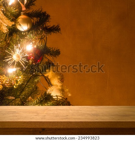 Wooden table on christmas tree - stock photo